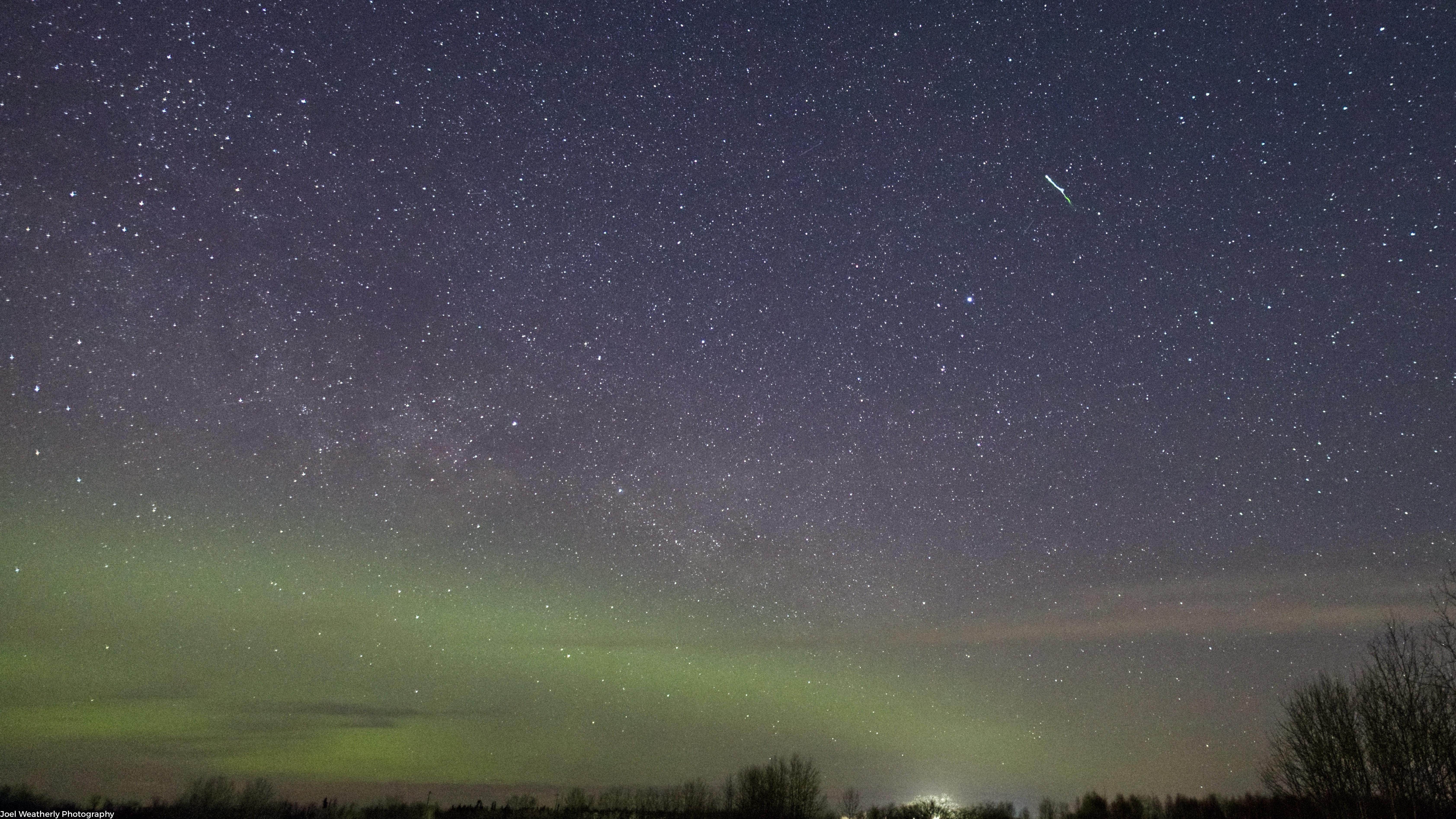 Lyrid Meteor Above Auroras